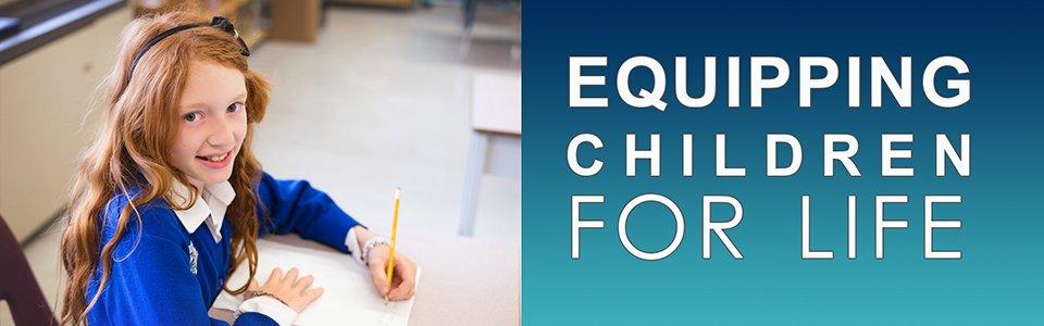 boy writing at Delta Christian School
